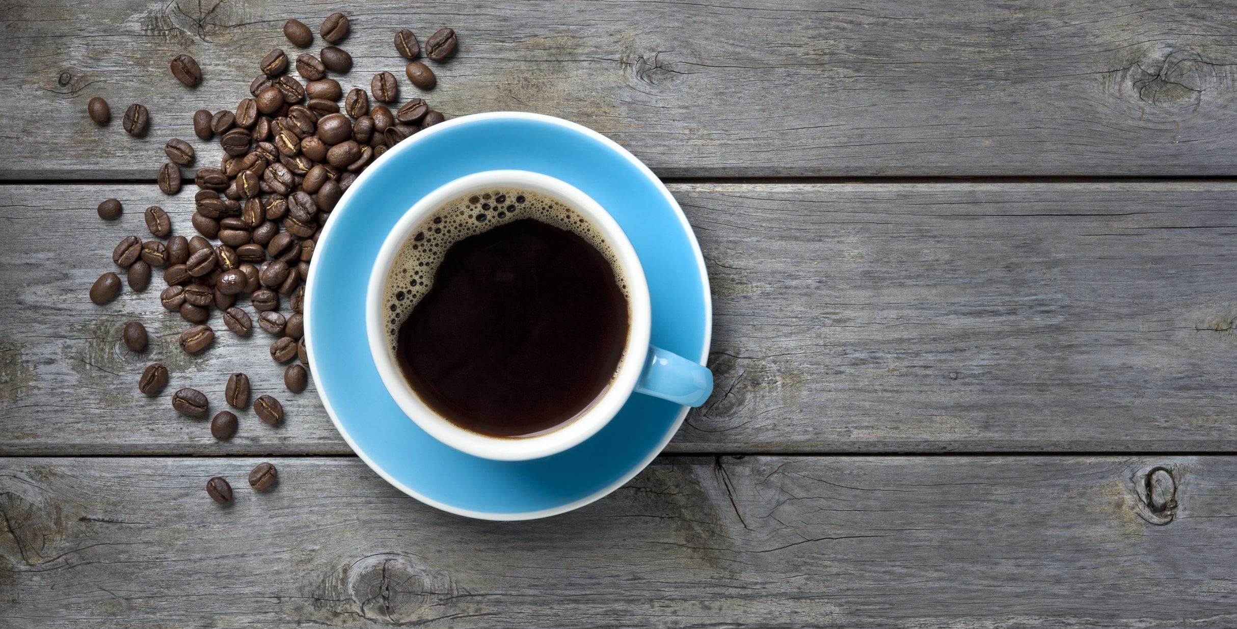 coffee-cup-beans-background-25165957-min