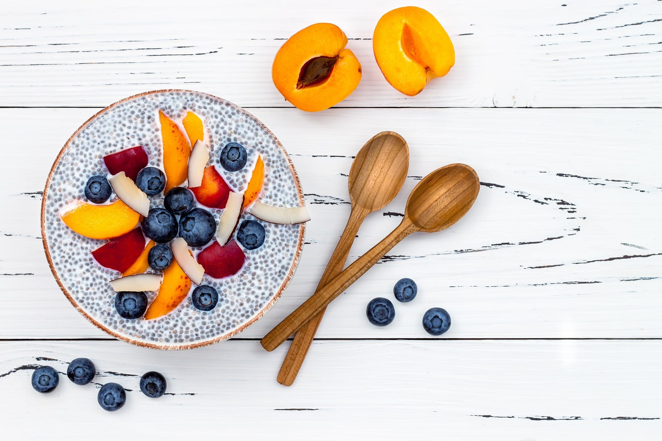 detox-and-healthy-superfoods-breakfast-bowl-concept-vegan-coconut-milk-chia-seeds-pudding-over-rustic-table-with-various-fruits-78204651-min