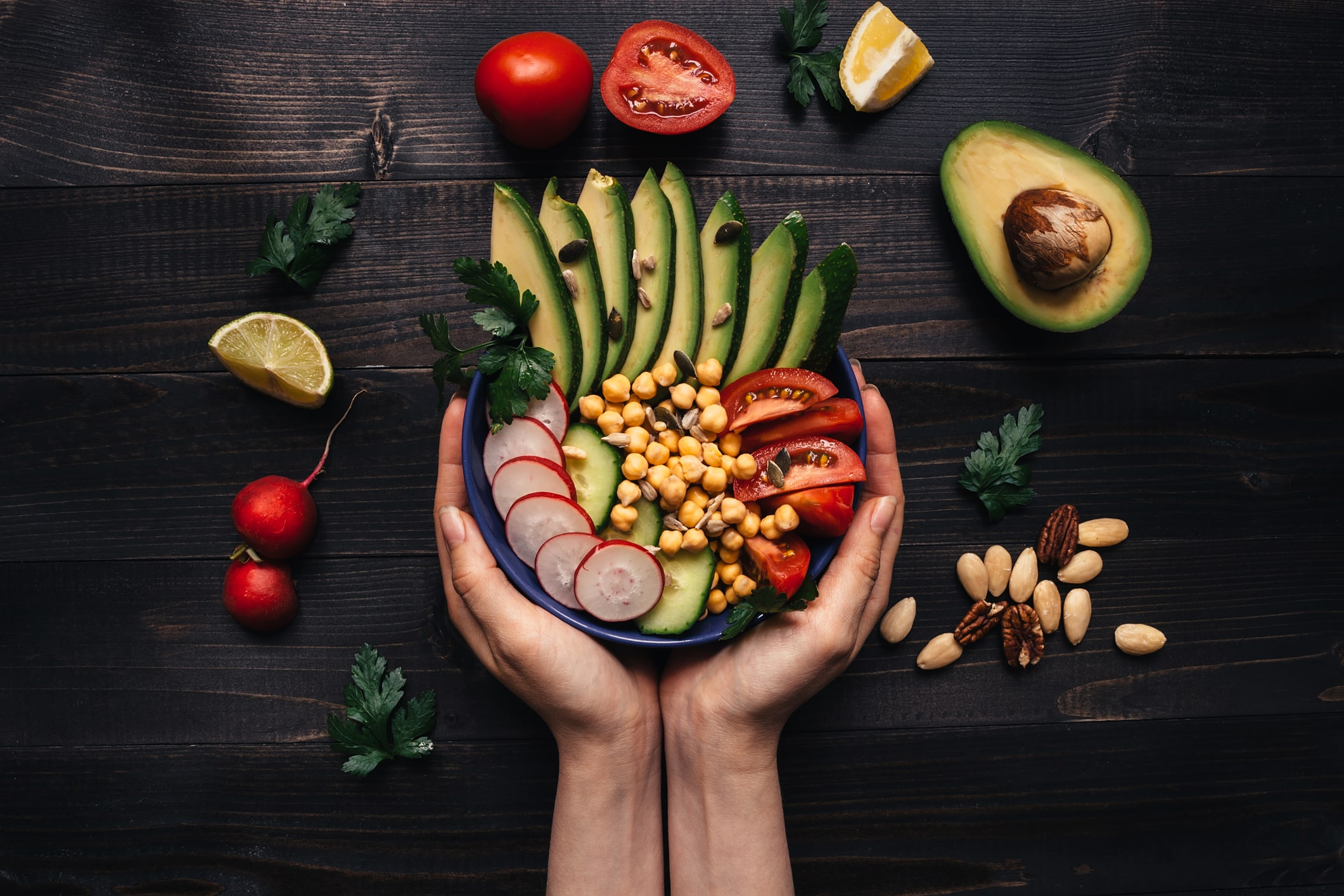 healthy-food-concept-hands-holding-healthy-salad-with-chickpea-and-vegetables-vegan-food-vegetarian-diet-91626256-min