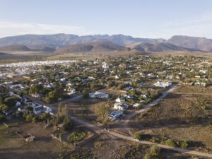 aerial-over-small-town-village-in-south-africa-mcgregor-177022417-min