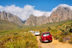 file-of-4x4-cars-driving-up-mountains-7134393-min