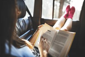 car-hire-cape-town-reading-in-car-min